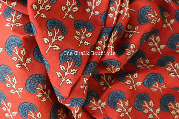 | Autumn Nights | Red Hand block printed dabu saree with blue border. TCB-POM4-RB4