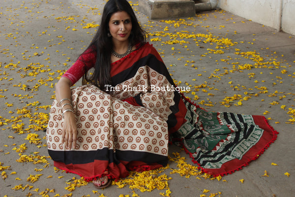 | Cinnamon Caramel Swirl | Hand block printed dabu saree with red border. TCB-POM9-RB4-The Chalk Boutique