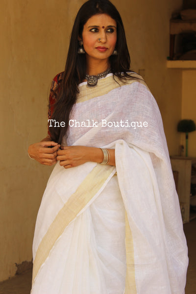 White with gold border khadi linen Saree with tassels. TCB-LIN5-C4