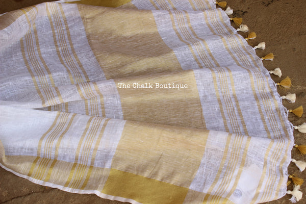 White with gold border linen Saree with tassels. TCB-LIN5-C4-The Chalk Boutique