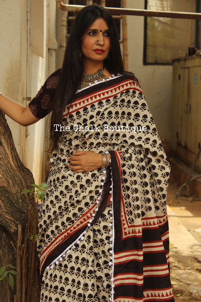 White Handblock printed dabu saree with contrast pom pom border. TCB-POM12-RB4-The Chalk Boutique