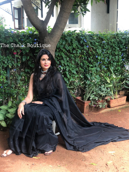 | Date Night | Black Pure cotton Saree with tasseled pallu.