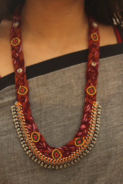 Braided cloth necklace.