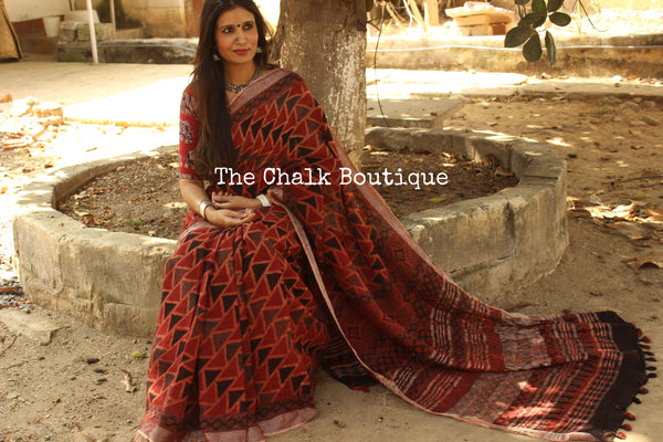 Madder Handloom Ajrakh linen saree with zari border and tasseled pallu. KCH-LIN3-C-The Chalk Boutique