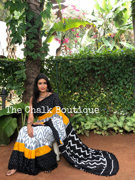 | Take Me Home | Black and Yellow printed cotton saree with black border.