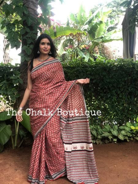 | Wilderness | Red Traditional Dabu Handblock printed Cotton saree.