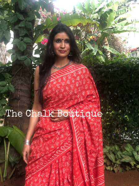 | Grishma | Orange Traditional Dabu Handblock printed Cotton saree.