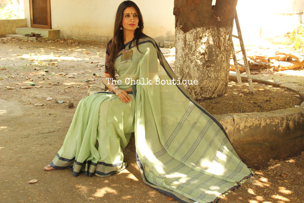 Soft self striped Handloom cotton saree with checked woven borders. TCB-PL2-JM