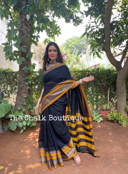 | Kajari | Black Soft Cotton Saree With Contrast Broad Temple Style Border.