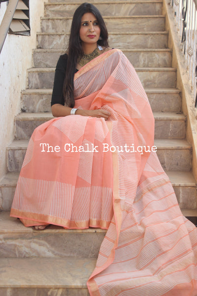 Peach Maheshwari silk hand block printed saree.