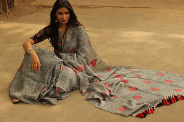 'Heart' grey linen saree with big tassels on the pallu. NF-JAM1-C5-The Chalk Boutique