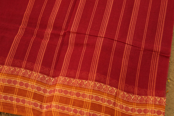 Red Handloom tant cotton saree with mustard woven border and contrast blouse fabric. TCB-TNT30-JM
