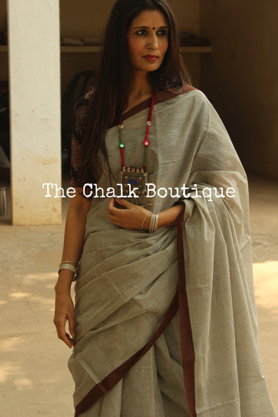 Grey 'Handloom mark' handwoven begumpuri saree with thin brown contrast border. TCB-PI4-BG