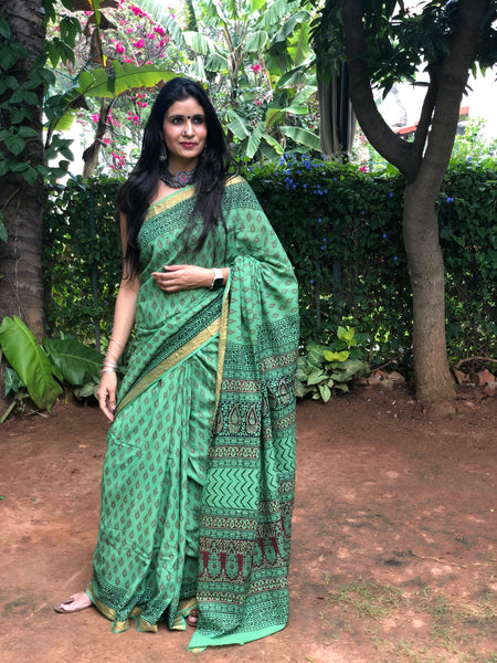 Green 'Bagh' hand block printed saree in Cotton.