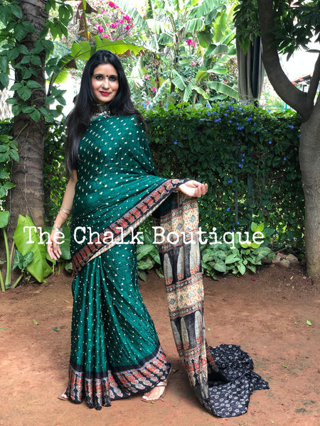 | Heera Panna | Green vegetable dyed Ajrakh saree with bandhani in modal Silk.