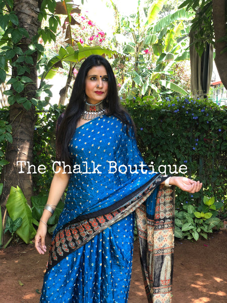 | Aquamarine | Vegetable dyed Ajrakh saree with bandhani in modal Silk.