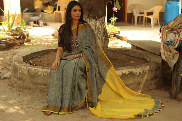 Grey self design woven linen saree with zari paar and contrast yellow pallu. TCB-YEL-CY