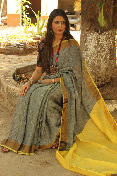 Grey self design woven linen saree with zari paar and contrast yellow pallu. TCB-YEL-CY-The Chalk Boutique