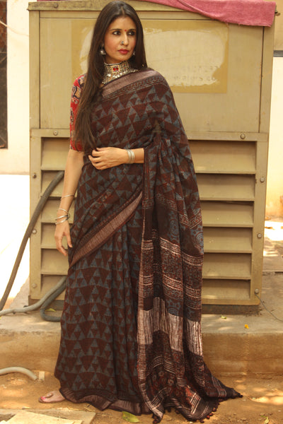 Handloom Ajrakh linen saree with zari border and tasseled pallu. KCH-LIN2-C11-The Chalk Boutique