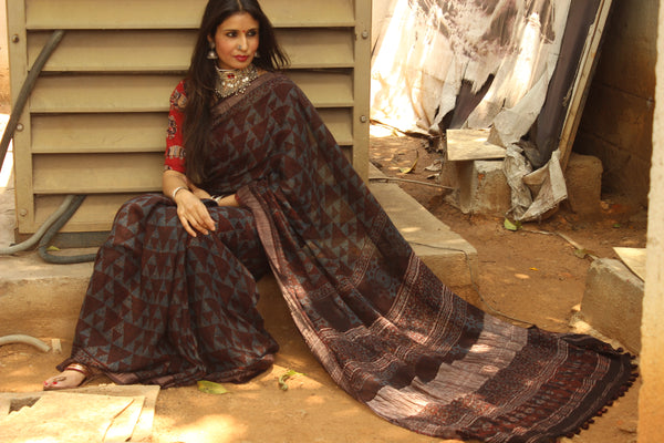 Handloom Ajrakh linen saree with zari border and tasseled pallu. KCH-LIN2-C11