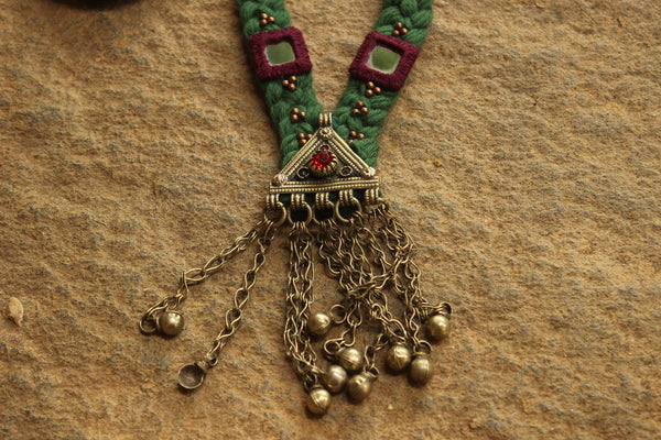 Green Braided necklace with antique german silver afghan pendant.