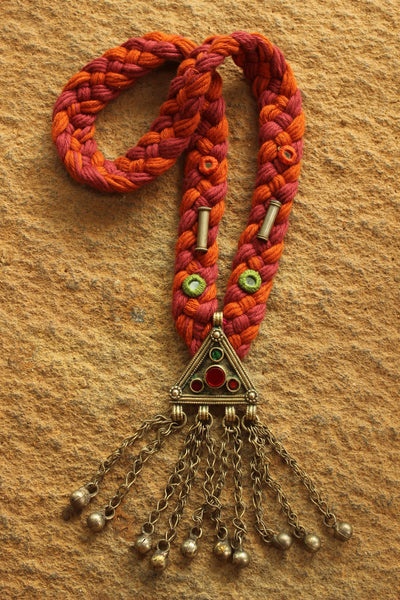 Orange and Pink Braided necklace with antique afghan pendant.