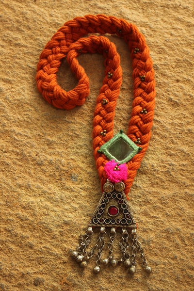Orange Braided necklace with antique afghan pendant.