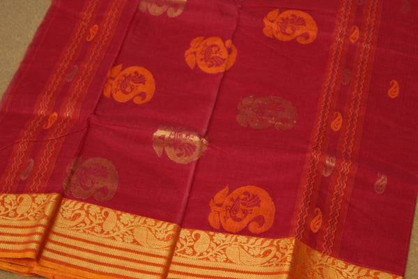 Red tant cotton saree with bootas all over, woven zari border and contrast blouse fabric. TCB-TZR2-AY
