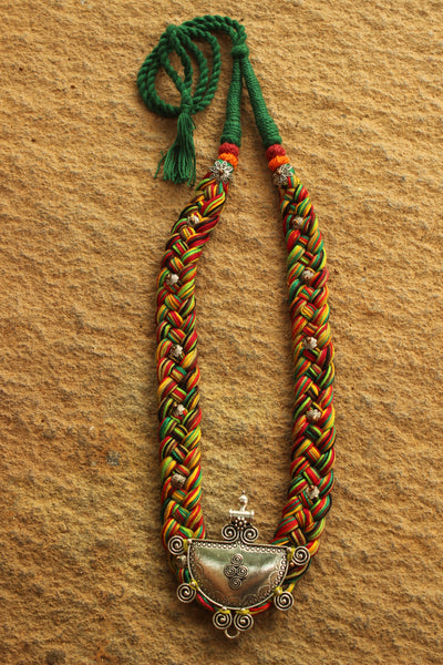 Green Multicolored Braided adjustable necklace with german silver pendant.