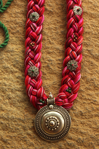 Pink Braided adjustable necklace with german silver pendant.