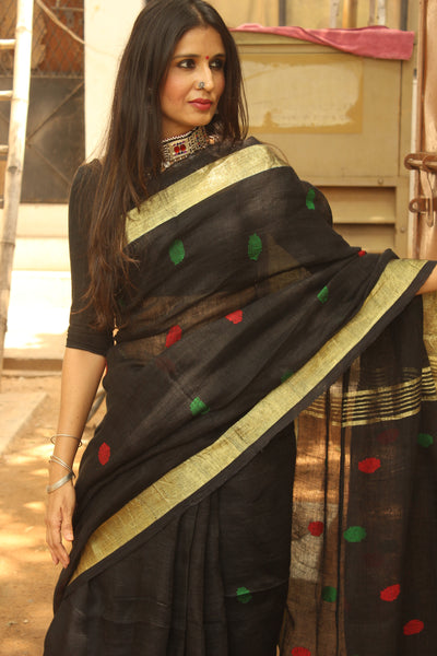 Black linen saree with zari paar and tassels on the pallu. NF-LJ-C5