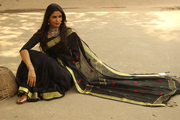 Black linen saree with zari paar and tassels on the pallu. NF-LJ-C5-The Chalk Boutique