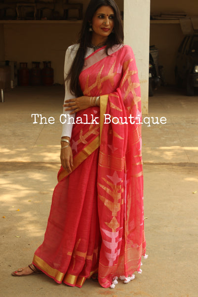 | Pink City | - Pink linen saree with design zari paar and tassels on the pallu. TCB-LIN4-AY