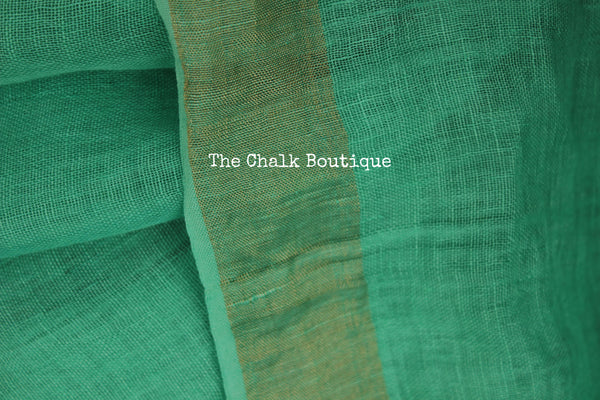 Plain sea green Linen saree with zari paar and tassels on the pallu. NF-LL1-C5-The Chalk Boutique