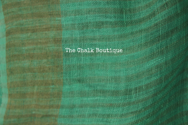 Plain sea green Linen saree with zari paar and tassels on the pallu. NF-LL1-C5