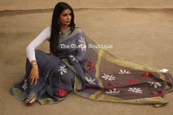 Linen saree with jamdani flower bootas, zari paar and tassels on the pallu. NF-JM-C5-The Chalk Boutique