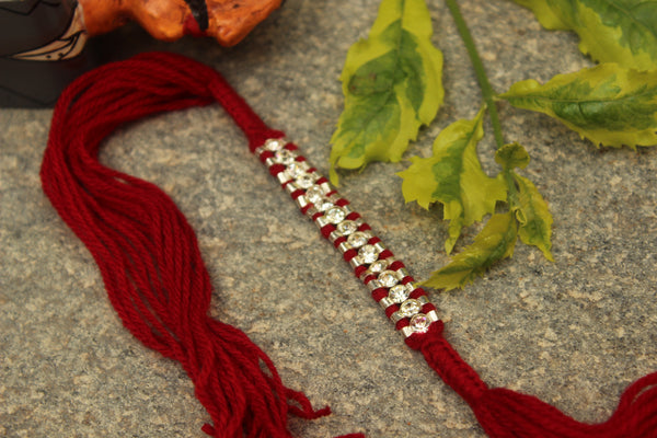 Hand Knotted rakhi with real garnets (Wristband) in silver . VA-AG18-10-a