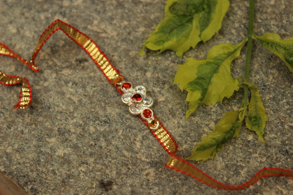 Gota patti rakhi with real garnets (Wristband) in silver . VA-AG18-11-c