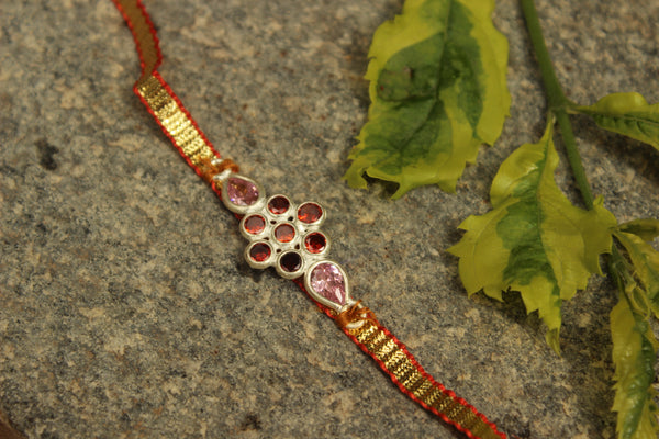 Gota patti rakhi with real garnets (Wristband) in silver . VA-AG18-11-e