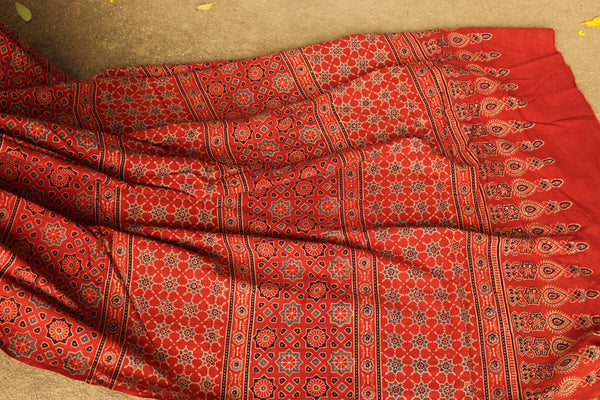 Handwoven vegetable dyed Ajrakh mul cotton saree in madder red. KCH-AJR9-C4