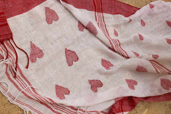 White 'Heart' laal paar linen saree with tassels on the pallu.