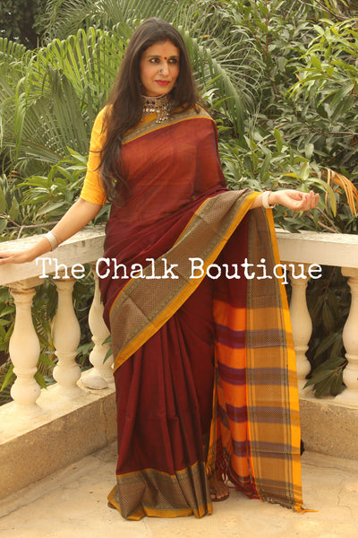 | Oudh | Maroon Soft Cotton Saree With Contrast Broad Border.