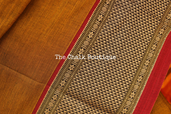 | Peetal | Brass Colour Soft Cotton Saree With Contrast Broad Border.