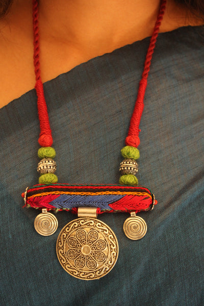Lambani roll necklace with german silver pendant.