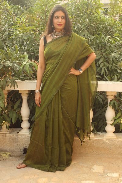 | Circle of Love | Green Pure cotton Saree with tasseled pallu.