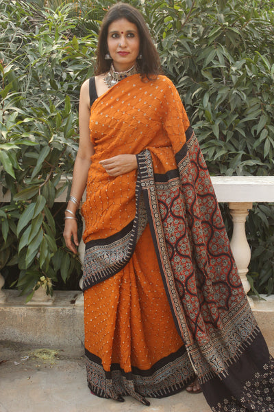 | Afsaana | Mustard vegetable dyed Ajrakh saree with bandhani in cotton Silk.
