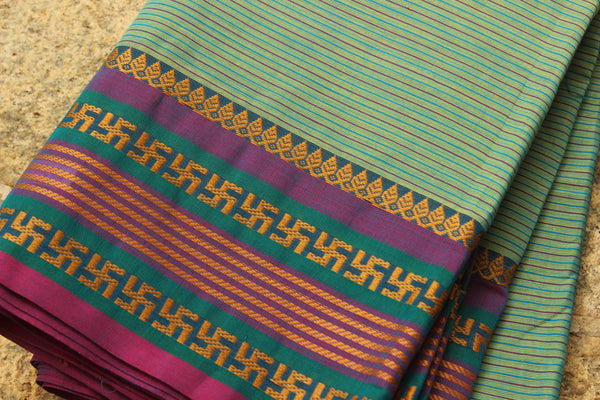 Sea Green Self Striped Cotton Saree with contrast Woven Border.