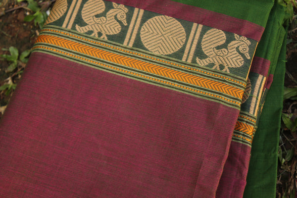 Green Cotton Saree with contrast Woven Border.