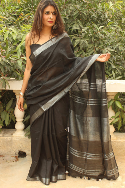 | Aham Brahmasmi | - Black linen saree with silver zari and tasseled palla