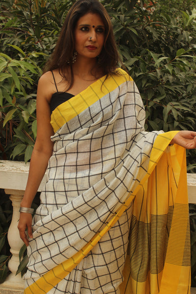 Yellow Checked linen saree with contrast border and tasseled palla